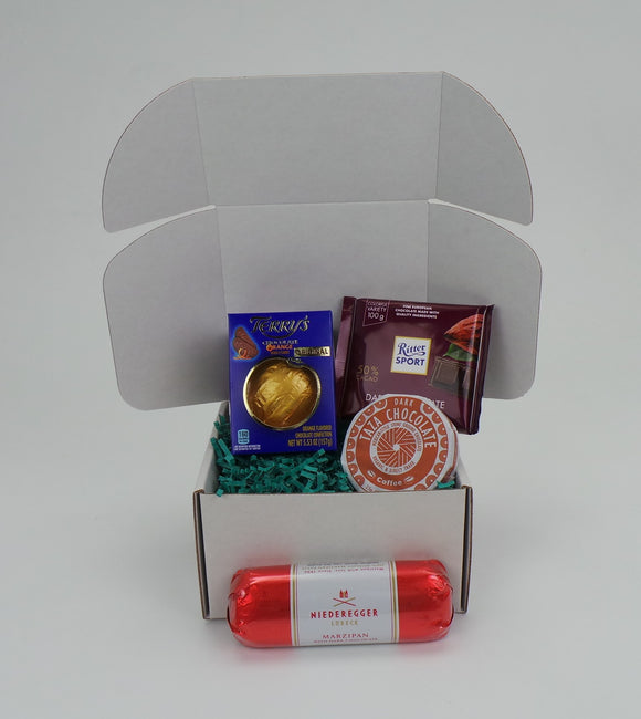 World Traveler Gift Set Small. Assortment of 4 products from multiple brands from around the world. Gift packaged. Compiled by Sweet Cloud Gifts, USA.