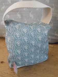 Handmade small door stop in pretty Olive and Daisy fabric