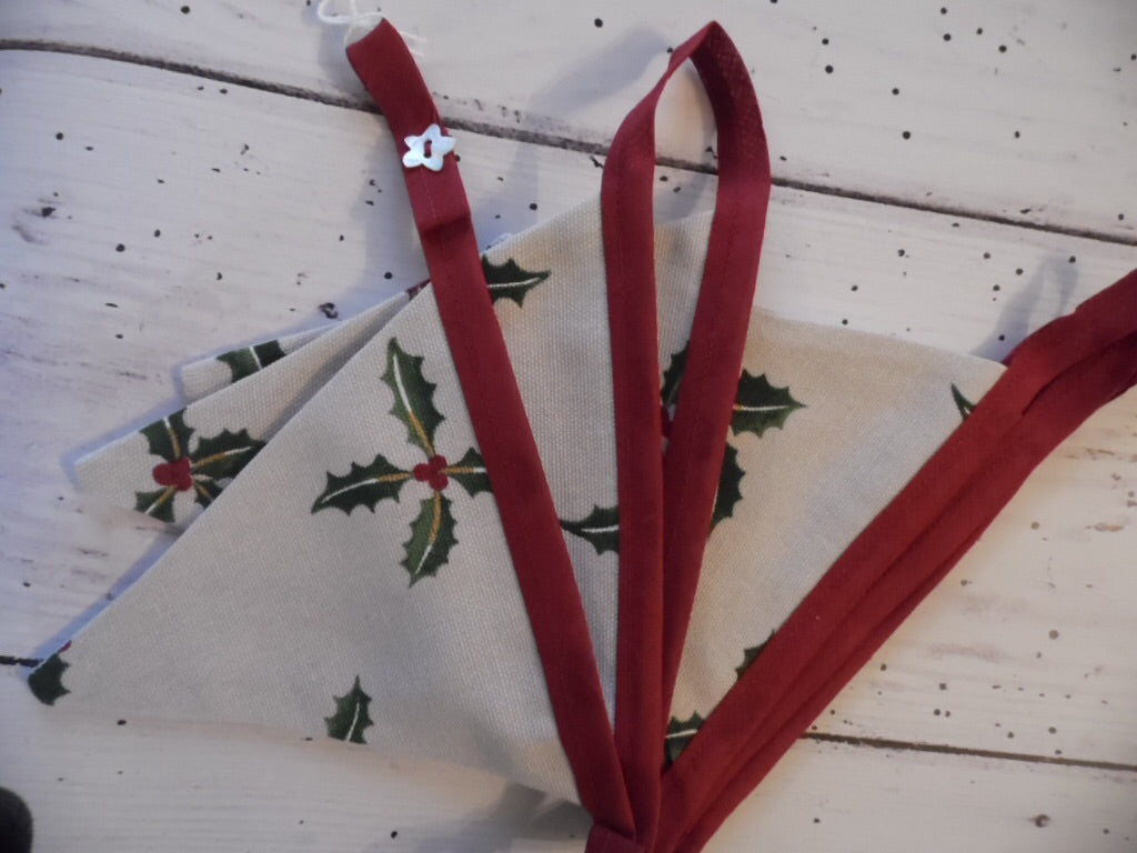 Handmade Christmas bunting in Sophie Allport 'Holly'