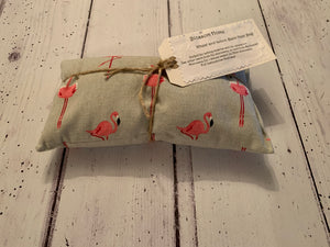 Wheat and Lemon Balm Heat pack. In Sophie Allport Flamingo