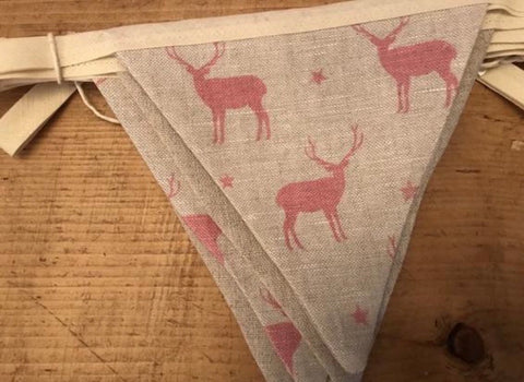 Handmade Bunting in Peony and Sage Stags with a plain natural linen reverse