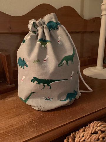 Handmade drawstring wash bag in Sophie Allport Dinosaur fabric with a waterproof lining