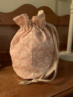 Handmade drawstring wash bag in Peony and Sage Isla  with waterproof lining