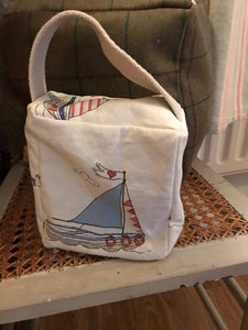 Handmade small door stop in a pretty Nautical themed pastel coloured sailboat fabric