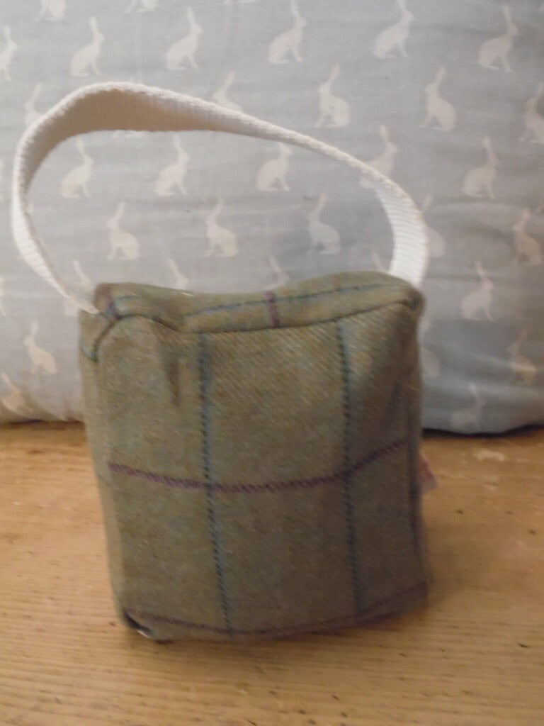 Handmade small door stop in the a lovely Tweed fabric by Abraham Moon