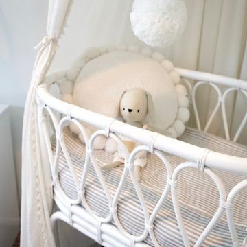 Gigi White Cane Bassinet _ The Cane Collective