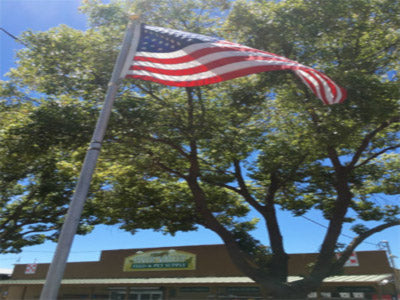 American flag in front of store