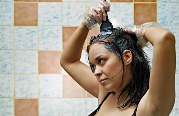 women coloring her hair at home