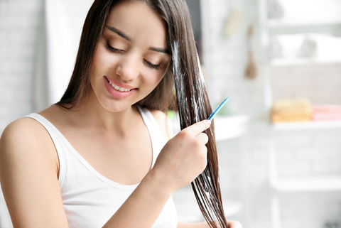 Women applying conditioning hair mask