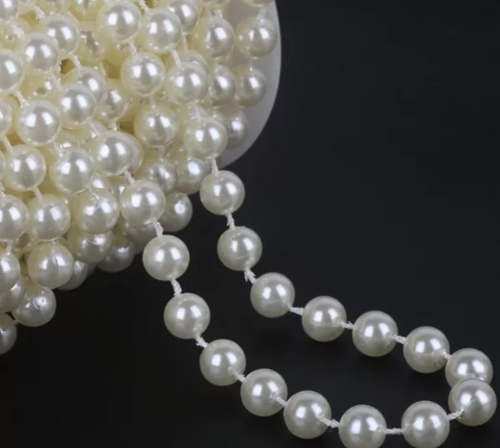 WHITE PEARLY STRING WITH LARGE PEARLS