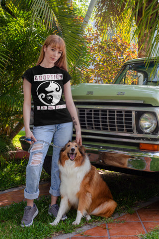 Woman wearing Adoption is the Only Option T-Shirt Standing with Pet Dog