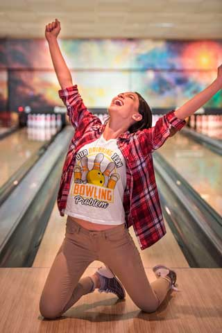 Woman wearing Our Drinking Team Has A Bowling Problem at bowling alley