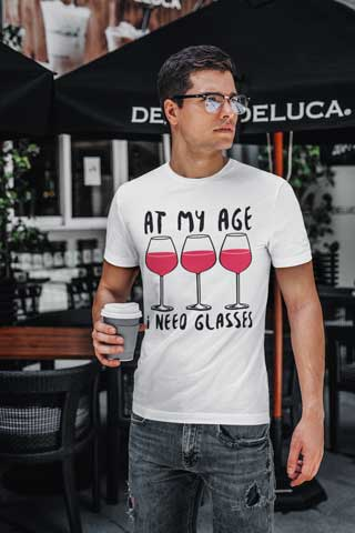 Man wearing At My Age I Need (Wine) Glasses T-Shirt