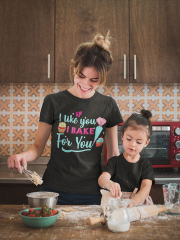 Woman wearing Bake For You T-Shirt while baking with daughter in kitchen