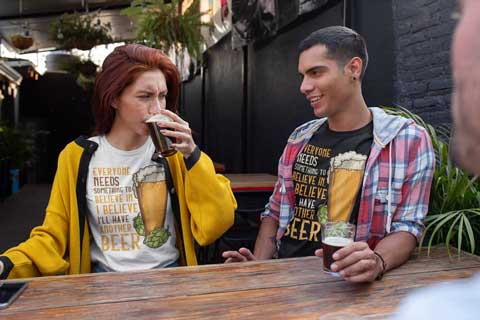 Man and woman wearing I Believe I'll Have Another Beer T-Shirts