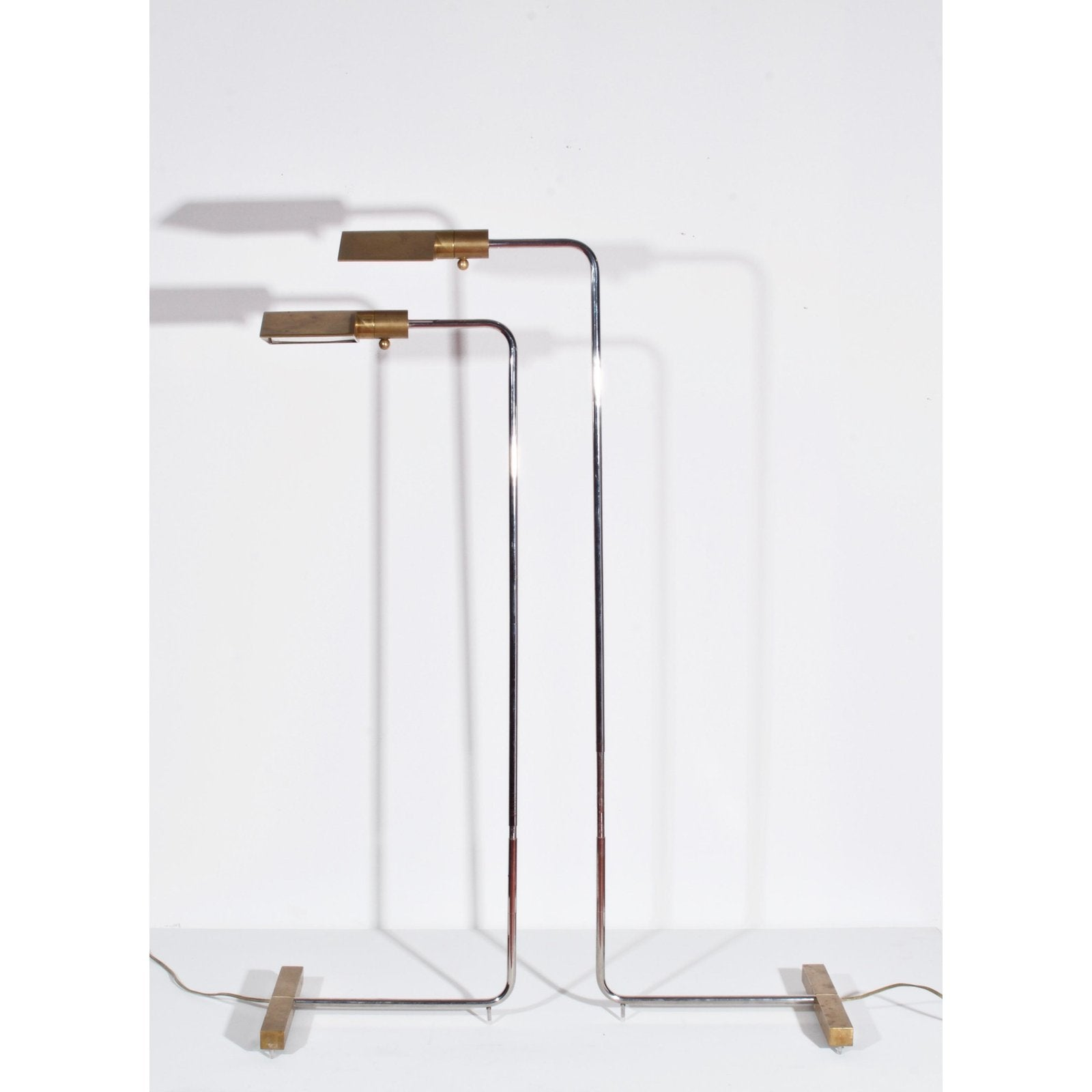 CEDRIC HARTMAN EARLY PAIR OF BRASS AND CHROME SWIVEL FLOOR LAMPS, 1960'S