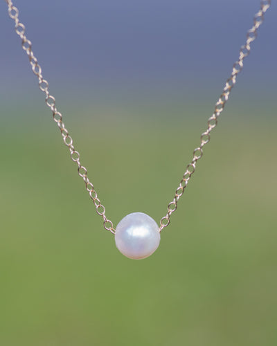 floating pearl necklace in gold