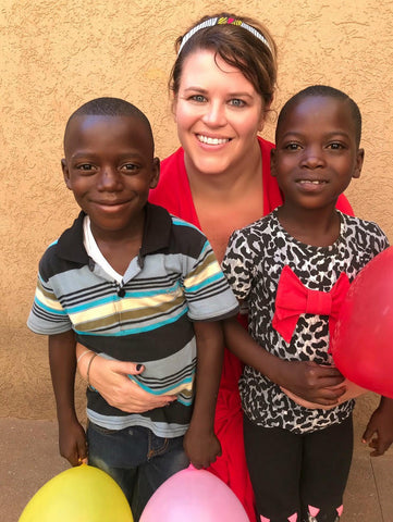 moon and lola kelly shatat with children and ballons in togo africa