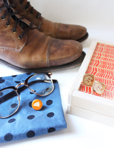 Moon and Lola - lapel pin and cufflinks next to brown hightop oxford boots