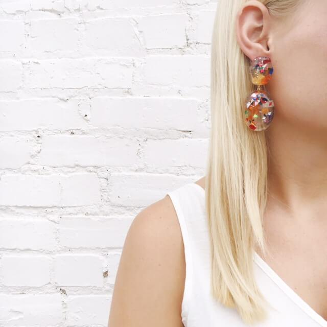 Moon and Lola thimblepress resin confetti earrings in warm colors