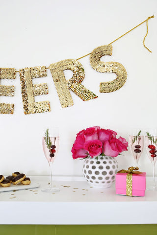 a beautiful mess sequin banner cheers how to diy