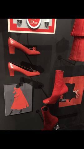 moon and lola red shoes and boots at dior in paris france