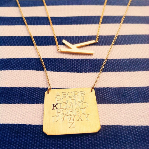 I found this at #moonandlola - Eyechart Necklace with Metal Varsity Necklace