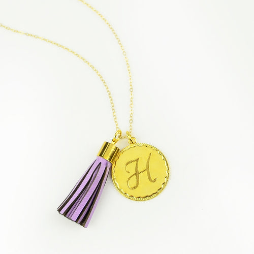 Leather Tassel Charm and metal initial charm on a long chain necklace - I found this at #moonandlola