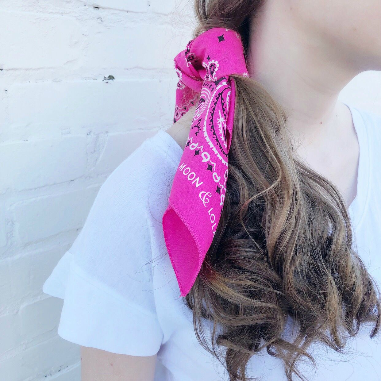 Moon and Lola - Traditional Bandana in Hot Pink on a side ponytail