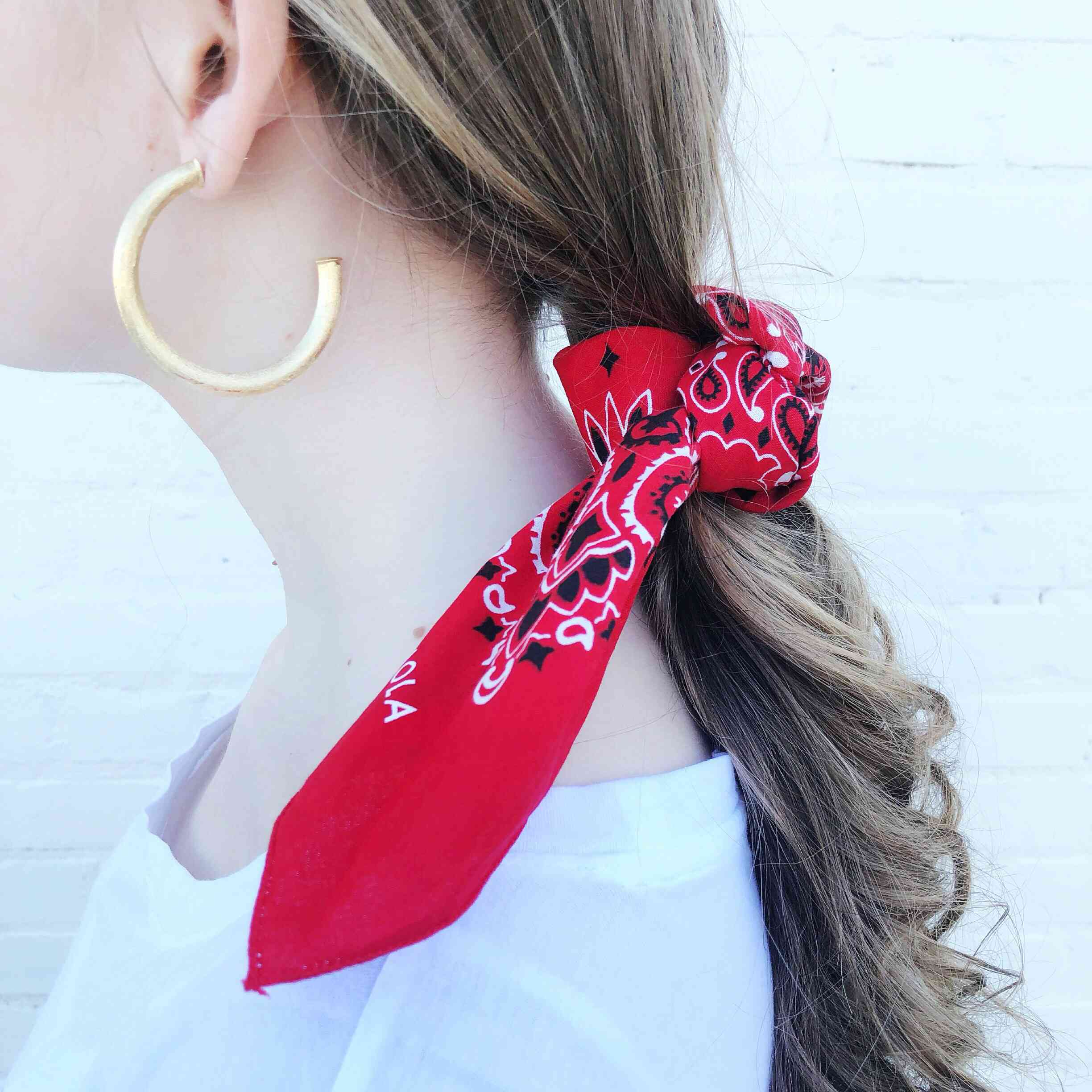 Moon and Lola - Traditional Bandana in Red tied to ponytail
