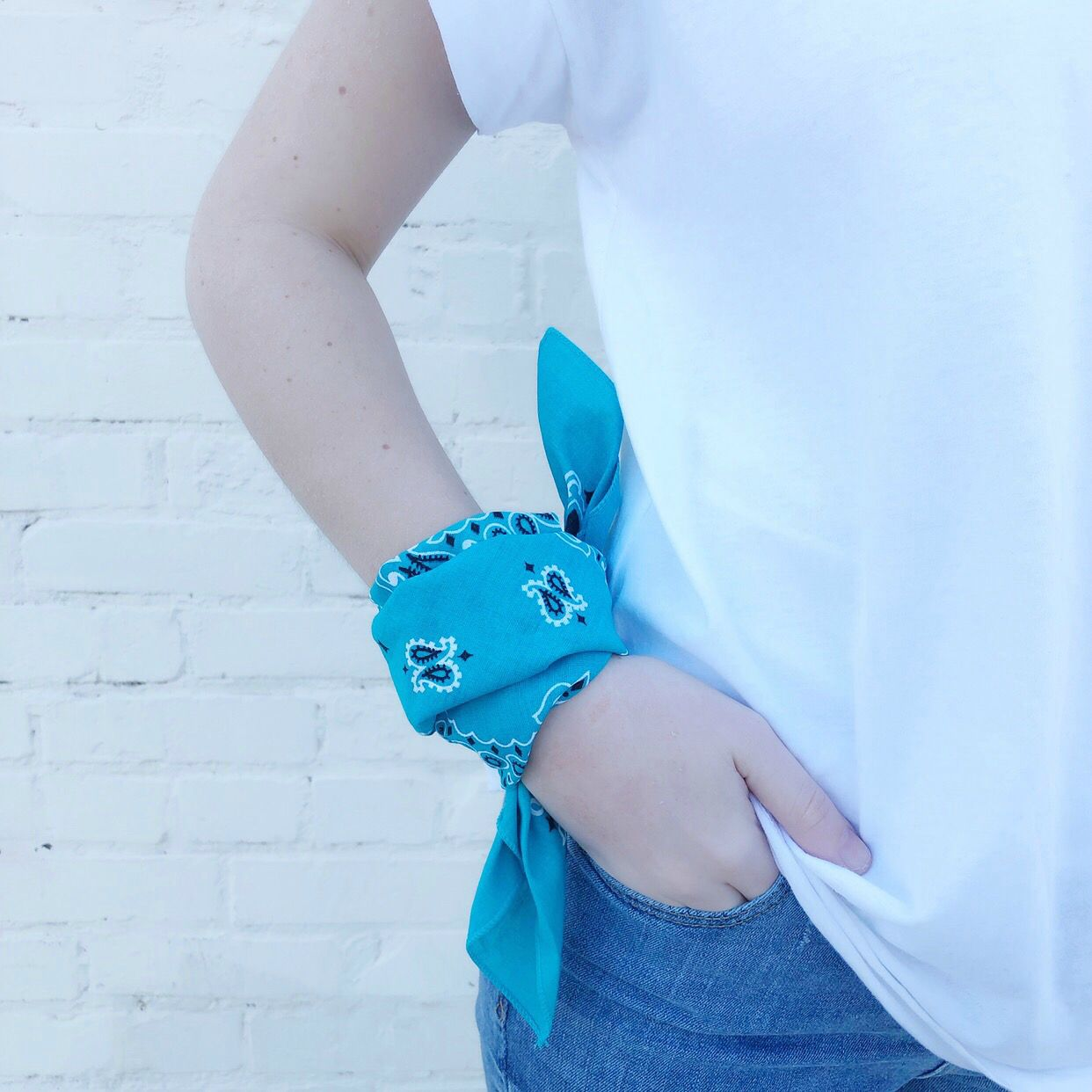 Moon and Lola - Traditional Bandana in Turquoise tied around your wrist