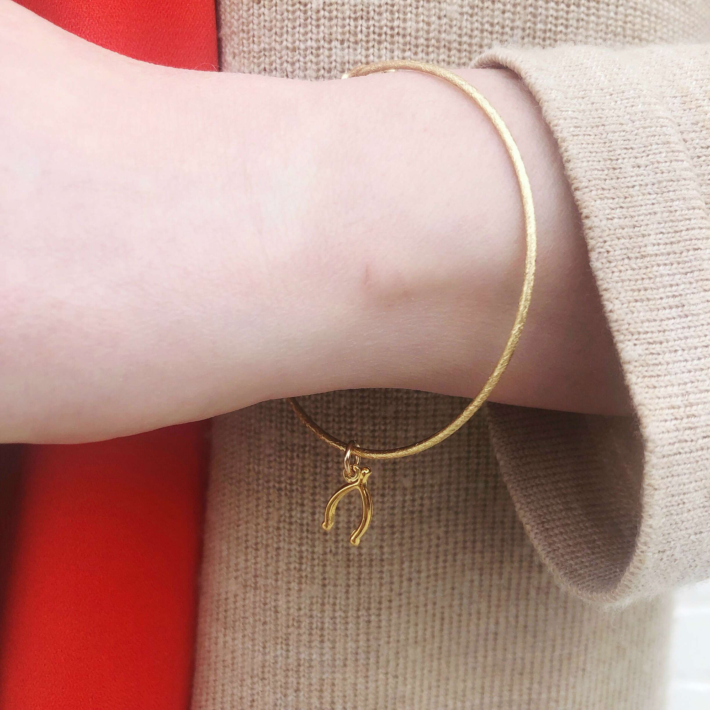 Moon and Lola - Wishbone Charm on a sleek Nora Bangle Bracelet