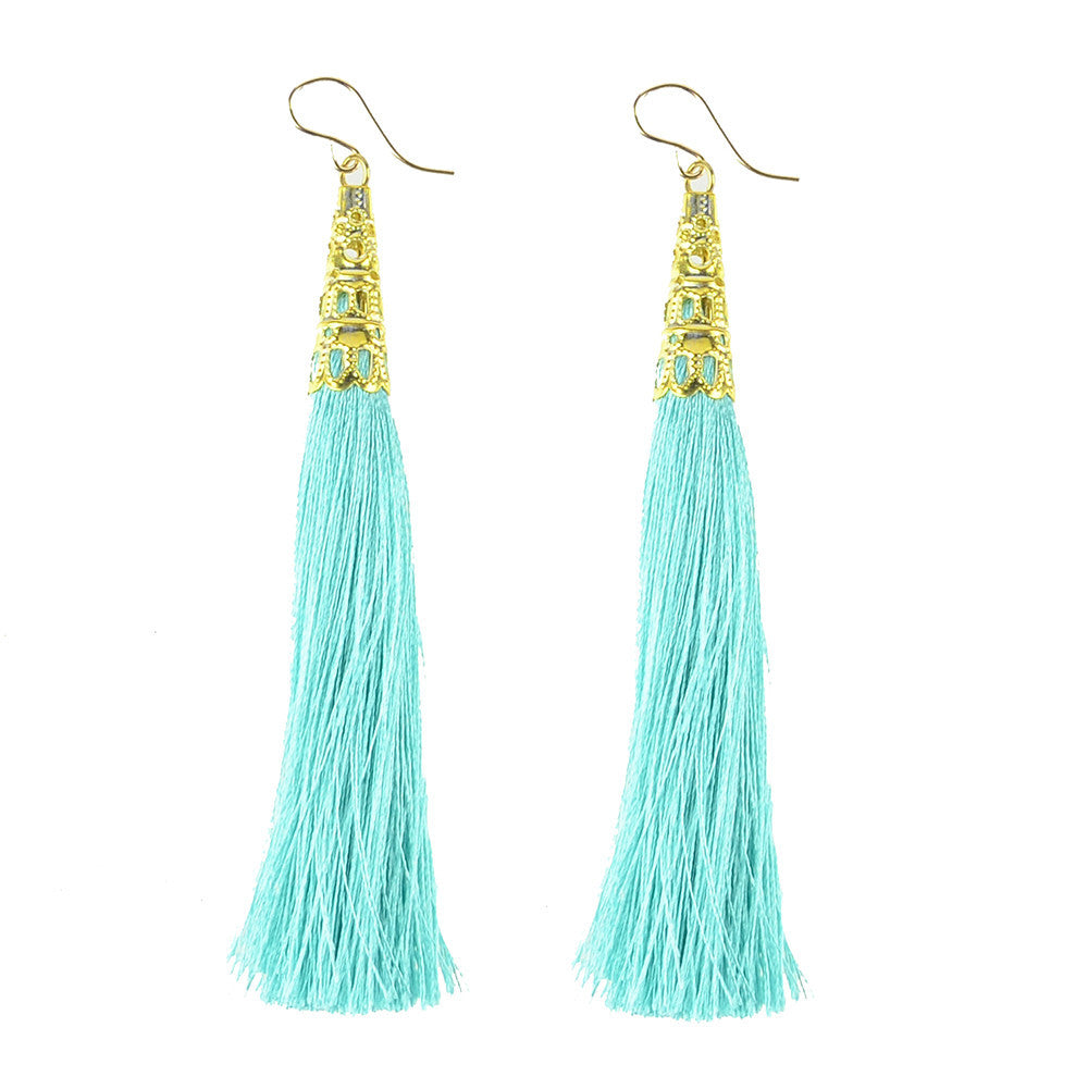 Phi Phi Earrings - silk tassels with a gold filigree cap at #moonandlola!