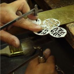 Moon and Lola production of hand-drawn hand-cut fine metals