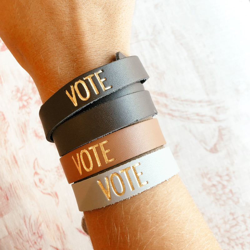 Moon and Lola - Sayre Gold Foil VOTE Bracelets stack of four on model