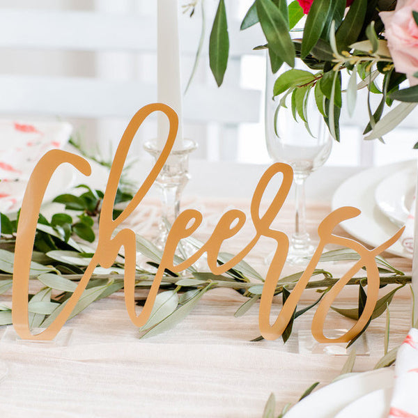 I found this at #moonandlola! - Cheers Tabletop Sign in Antique Gold
