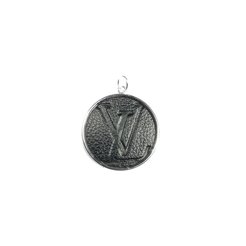 Featuring repurposed authentic Louis Vuitton handbag materials, our Leone Round Charm features the embossed monogram empreinte leather inset into a gold or silver bezel.