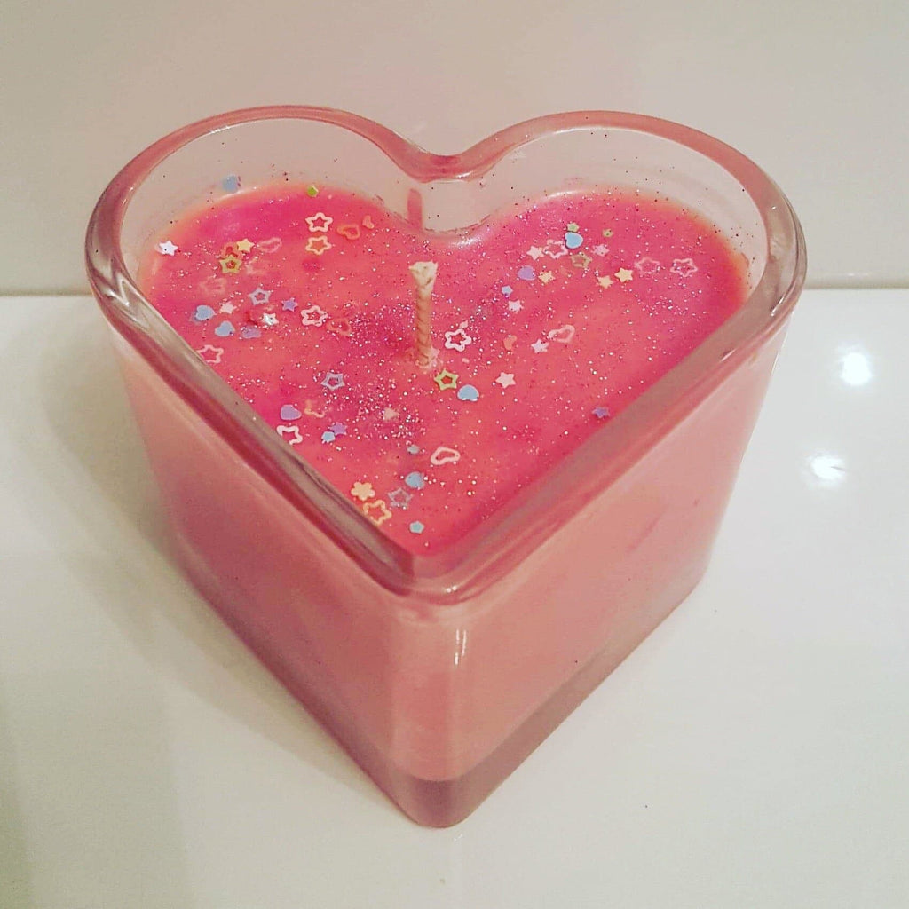 Love spell heart candles with a hint of glitter and sequins