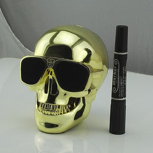Skull Bluetooth Speaker compared to a black marker to show its size, hight is approximately as high as the black marker