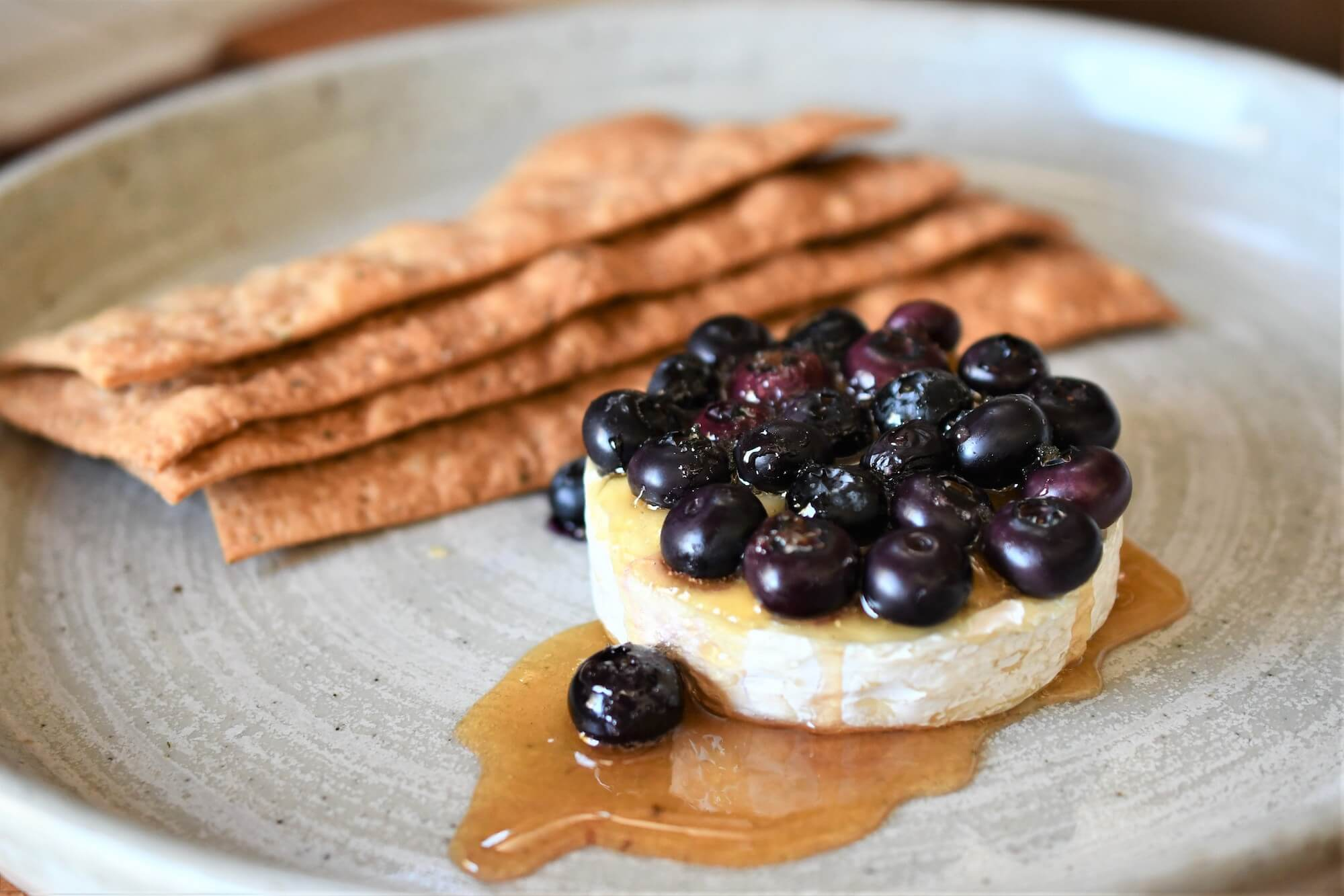 Baked Brie Cheese with Blueberries and Honey