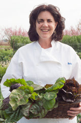 chef becky holding vegetable harvest