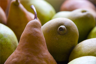 A clustered mix of green and golden pears.