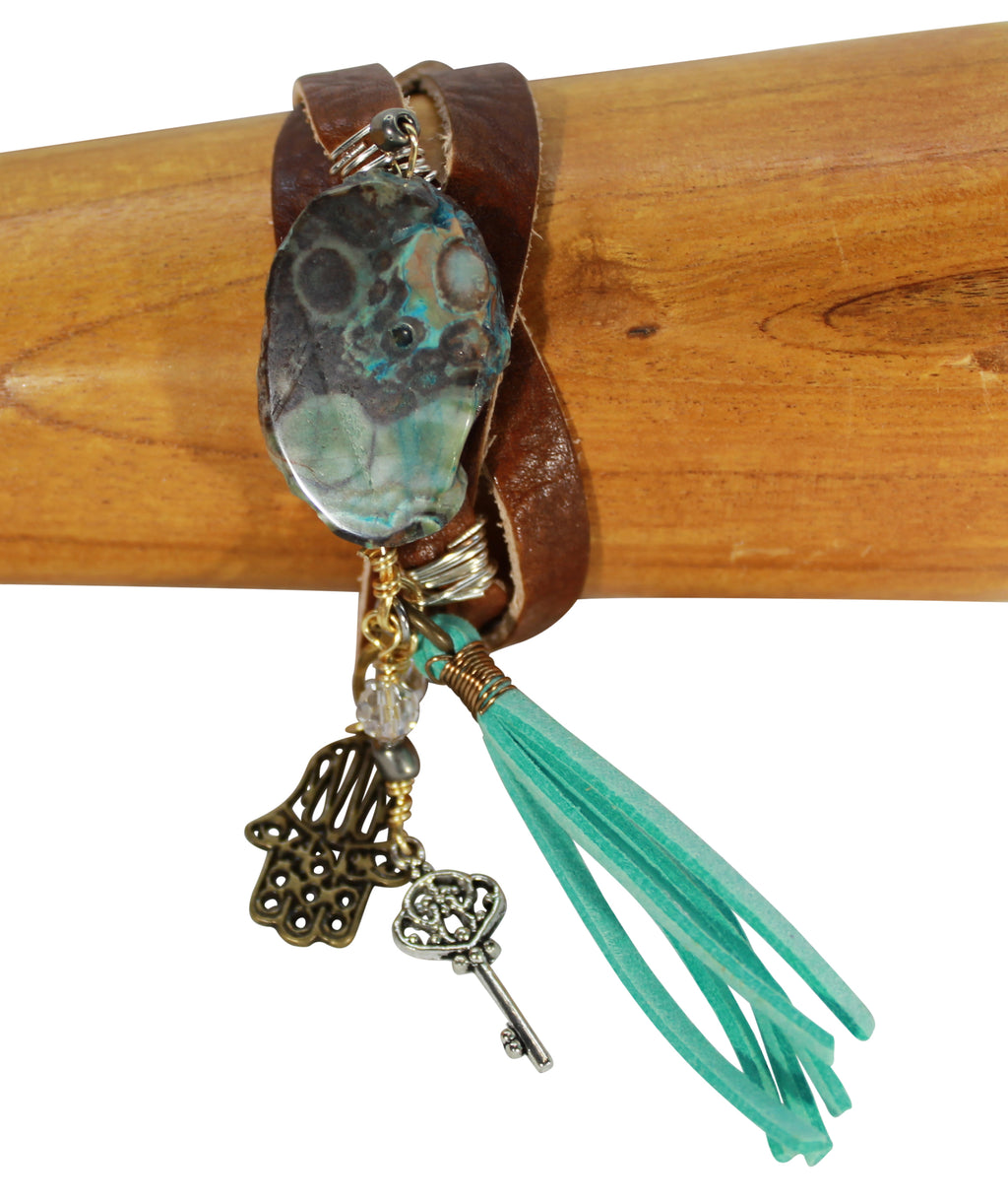 Vegetable tanned leather bracelet, turquoise stone, tassel on charm bracelet, leather jewelry cuff