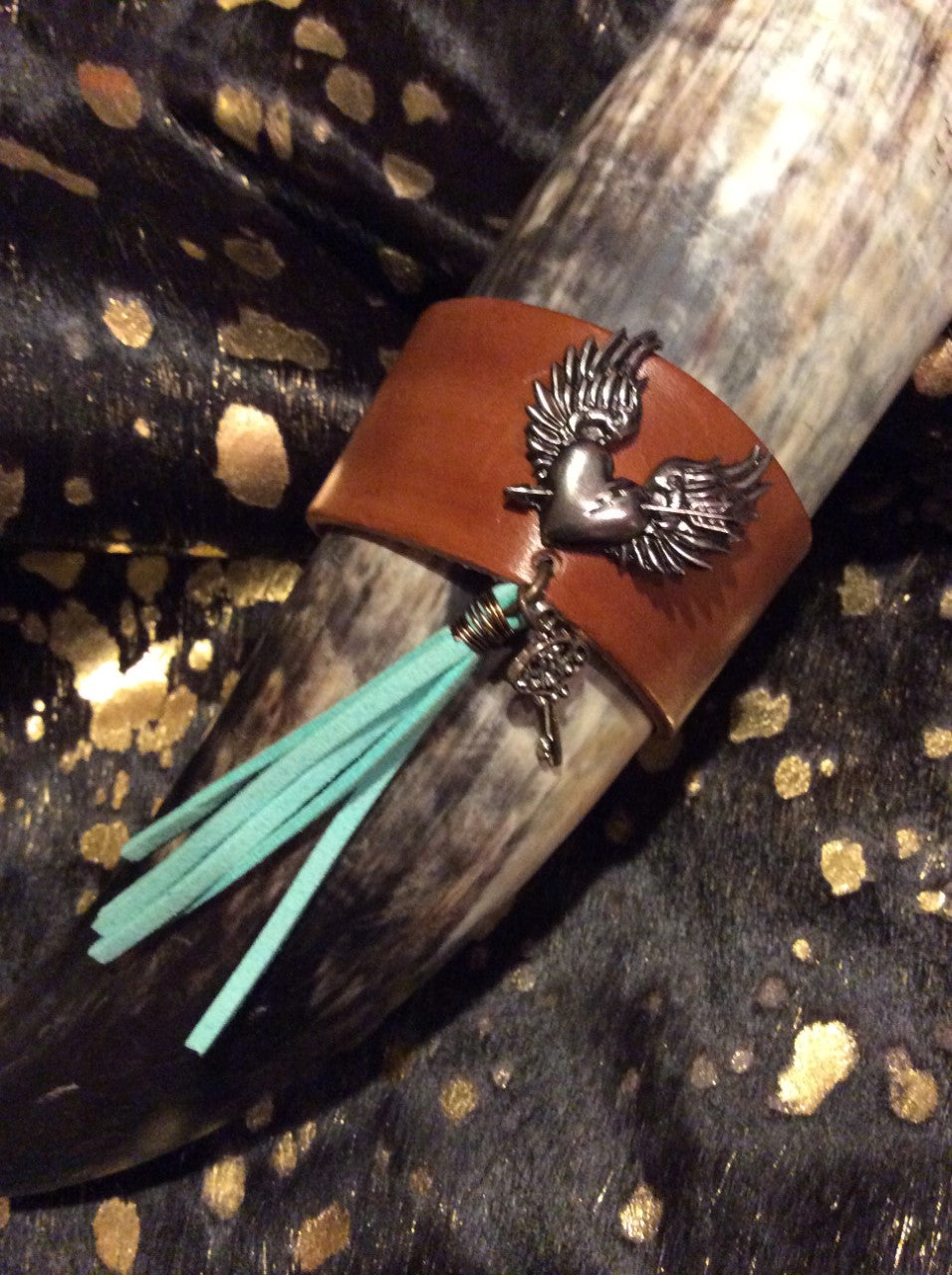 Vegetable tanned leather bracelet, heart wing bracelet, leather cuff, turquoise tassel, leather jewelry