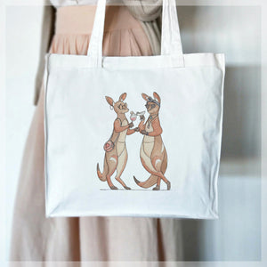 A white, 100% cotton tote bag featuring two fashionable wallabies sharing cocktails. Illustrations by Stephanie Gray.