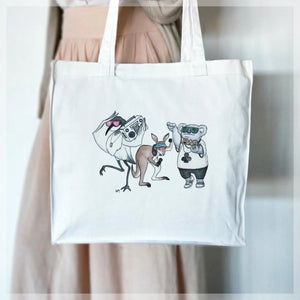 A white, 100% cotton tote bag featuring an australian hip hop animal band. Illustrations by Stephanie Gray.