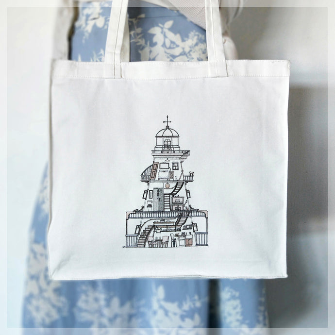 A white, 100% cotton tote bag featuring a lighthouse cut-away with 10 hidden cats. Illustrations by Stephanie Gray.