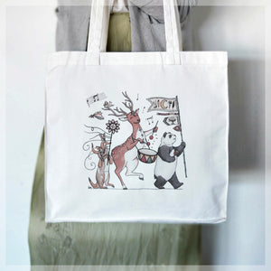 A white, 100% cotton tote bag featuring autumn themed animals in a musical parade. Illustrations by Stephanie Gray.