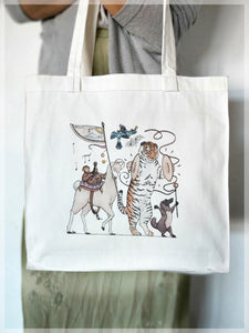 A white, 100% cotton tote bag featuring summer themed animals in a musical parade. Illustrations by Stephanie Gray.