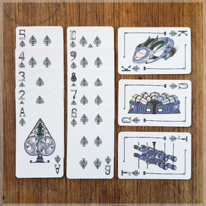 Hand Illustrated Steampunk playing cards showing the suit of spades. The picture cards show the engine room, weapons room and the full ship.